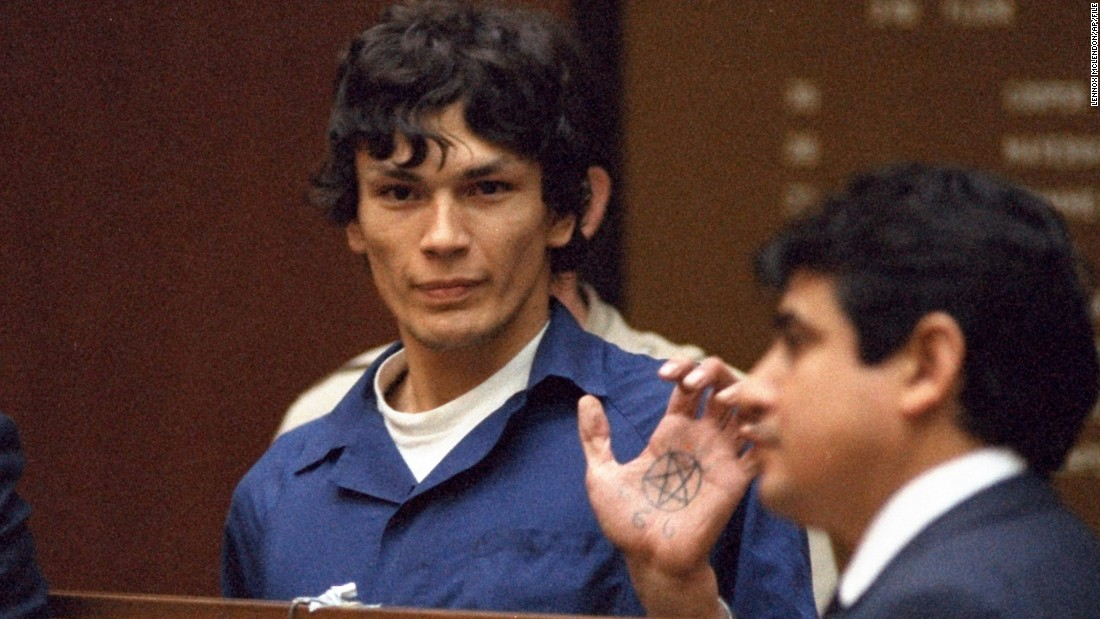 "Consultant Dimitrius says the longest jury selection might belong to the trial of Richard Ramirez, known as ""the Night Stalker."" It took nine months to seat a jury in the capital murder case against Ramirez. His spree of serial murders, rapes and home invasions terrified Los Angeles and San Francisco in the mid-1980s. He received 13 death sentences but died of cancer in prison. In this 1985 courtoom photo, Ramirez displays a pentagram symbol on his hand."