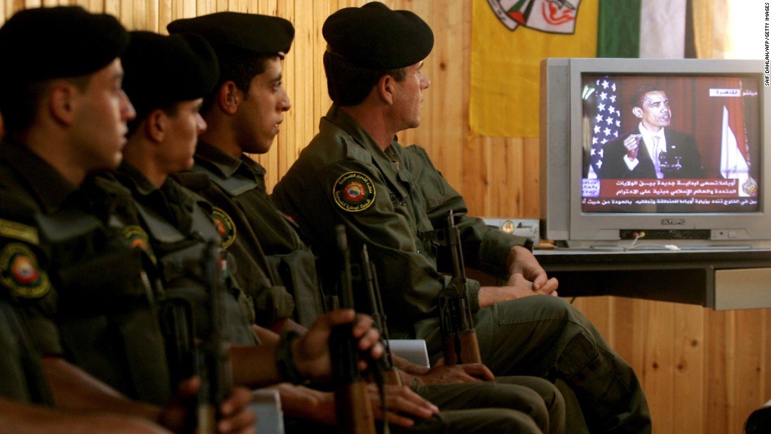 "Palestinian security forces in Jenin, West Bank, listen to Obama speak from Cairo University in Egypt in June 2009. The Palestinian Authority hailed as a ""good beginning"" Obama's speech to the Muslim world in which he reiterated his support for a Palestinian state."