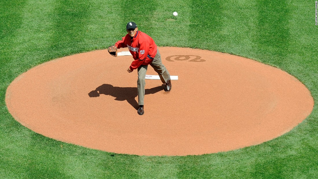 Obama throws out the opening pitch before a baseball game between the Philadelphia Phillies and the Washington Nationals in April 2010.