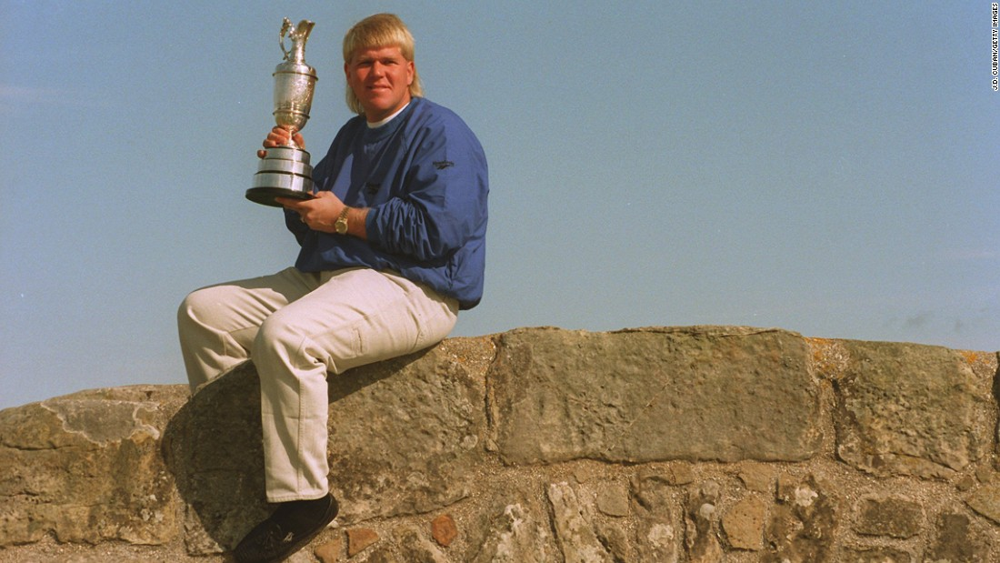 The trend of standing out on the links has been given new meaning by former Open champion John Daly in recent years. Although when he posed on St. Andrews' Swilcan Bridge with the Claret Jug in 1995, he wasn't quite so colorfully dressed.
