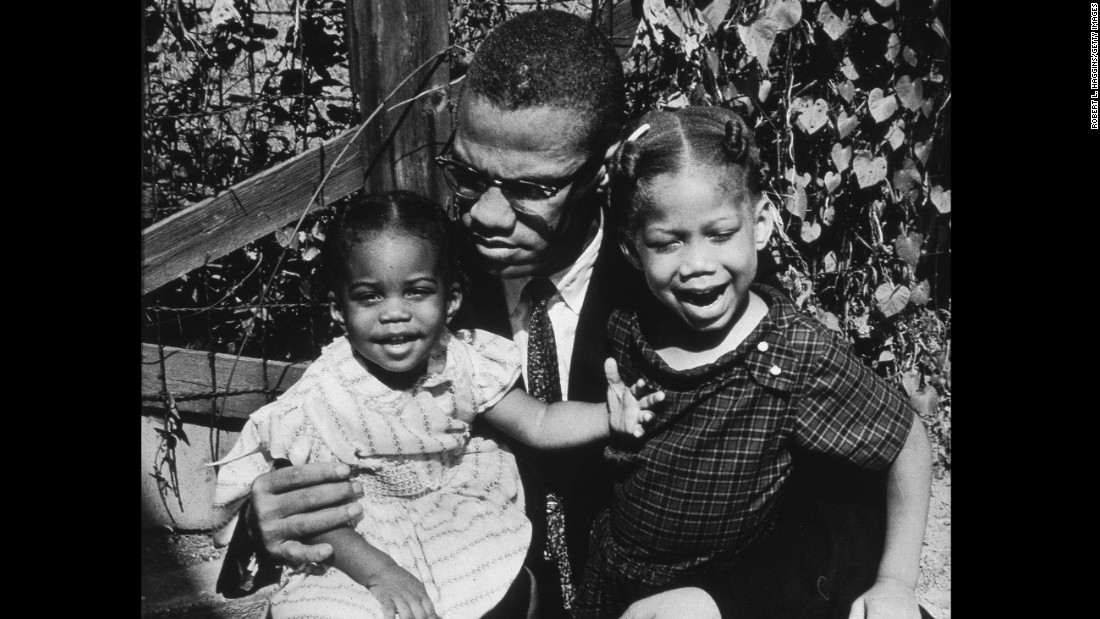 Malcolm X with his daughters Qubilah, left, and Attilah in 1963.