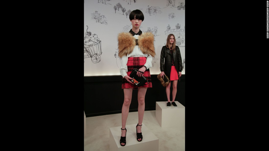 "Kate Spade's chief creative officer Deborah Lloyd drew some inspiration from ""Fantastic Mr. Fox,"" as evident in this look with a rich plaid and fox motif."
