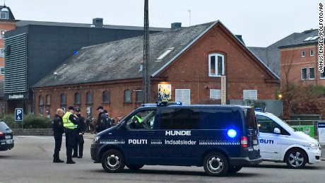 "Emergency services gather outside a venue after shots were fired where an event titled ""Art, blasphemy and the freedom of expression"" was being held in Copenhagen, Saturday, February 14. D"