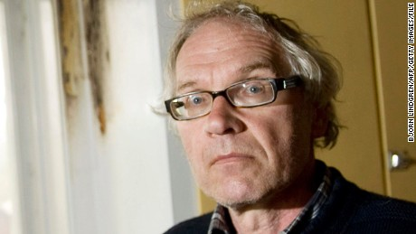 Swedish artist Lars Vilks is pictured near burn stains in his kitchen at his home outside of Hoganas on May 16, 2010. Police arrested two suspects after an attempted fire-bomb attack on the home of a Swedish cartoonist Lars Vilks, controversial for drawing the Prophet Mohammed with the body of a dog, they said today. Both suspects, aged 21 and 19, are Swedish nationals of Kosovar origin, from the southern city of Landskrona, and have been detained after personal items were found near the scene. AFP PHOTO/SCANPIX/Bjorn Lindgren (Photo credit should read BJORN LINDGREN/AFP/Getty Images)