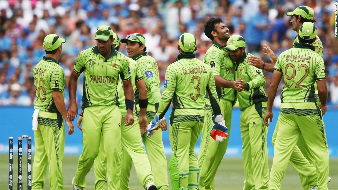 Sohail Khan is congratulated by his fellow Pakistan teammates on the way to five wickets in the Indian innings.