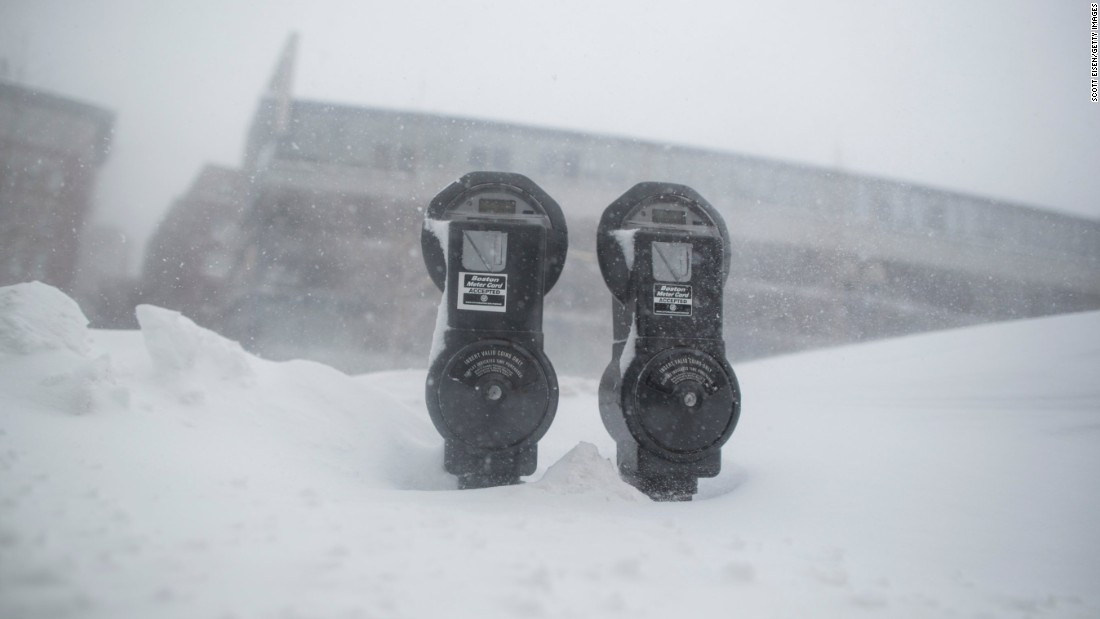 Snow nearly reaches the tops of parking meters in Boston on February 15.