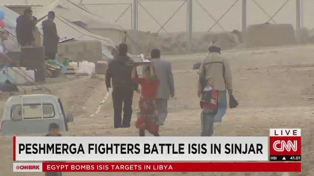 Kurdish peshmerga fighters battle ISIS in Sinjar