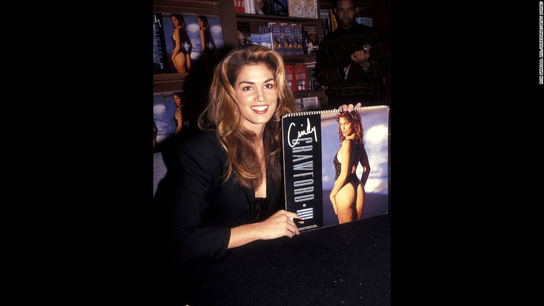 Crawford signs copies of her 1992 swimsuit calendar.