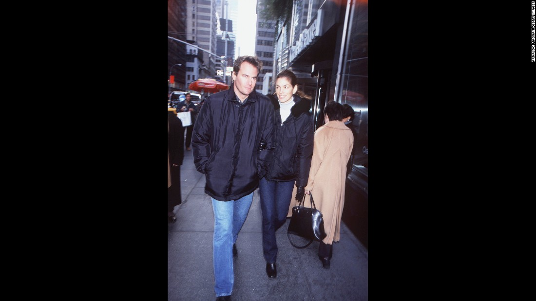 Crawford walks in New York with her second husband, businessman Rande Gerber. The couple has two children.