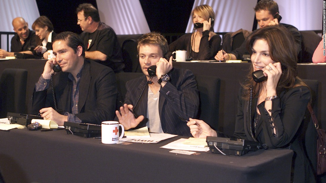 "Jim Caviezel, left, Ryan Seacrest and Crawford take calls during the ""Tsunami Aid: A Concert of Hope"" telethon in 2005."