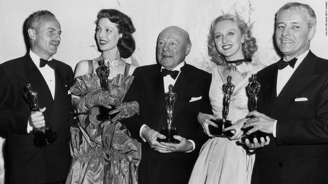 "Ronald Colman, far right, a star since the silent days, picked up the best actor Oscar as a jealous actor in ""A Double Life."" Coleman appears with the year's other winners at the 1948 ceremony -- from left, Darryl Zanuck, producer of best picture ""Gentleman's Agreement,"" best actress Loretta Young, best supporting actor Edmund Gwenn and best supporting actress Celeste Holm."