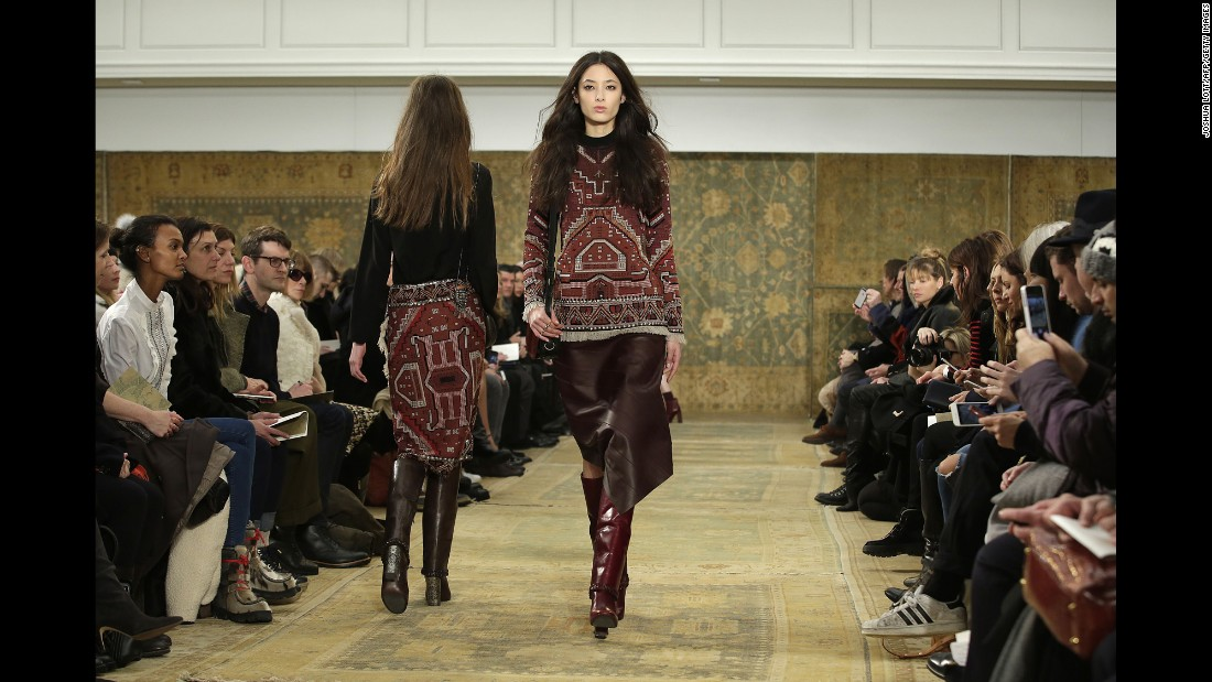 "Models stride down the runway in Tory Burch's ""Marrakech meets Chelsea"" collection."