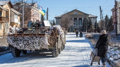 Ukrainian forces pass through the center of town on February 17, 2015 in Myronivskyi, Ukraine.