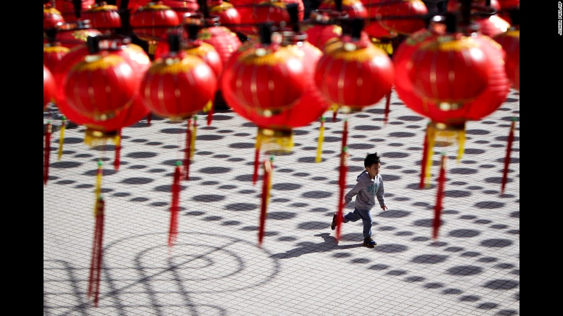 A boy runs through a temple with Chinese lantern decorations in Kuala Lumpur, Malaysia, on Tuesday, February 17.