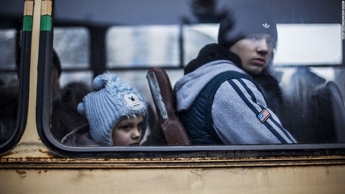 "Ukrainian children sit in a bus before fleeing Debaltseve, in the Donetsk region, on February 3, 2015. <a href=""http://cnn.com/2015/02/18/europe/ukraine-conflict/"">Ukraine's military said Wednesday </a>that 80% of Ukrainian armed forces have now pulled out of a strategic railroad hub that's been the focus of bitter fighting with pro-Russian separatists."
