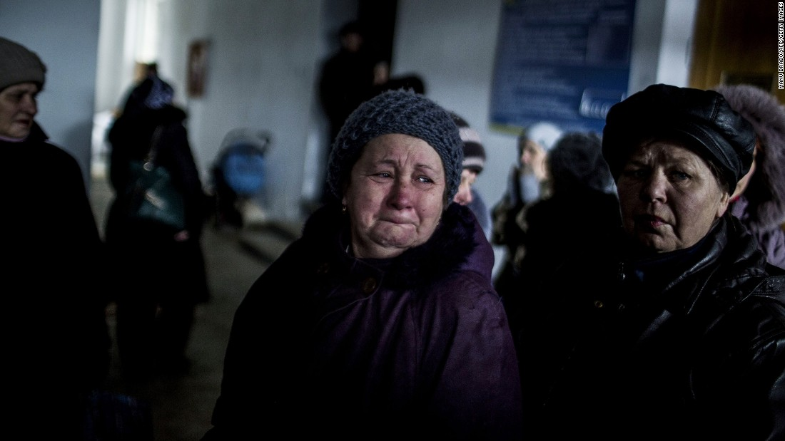 "A Ukrainian woman cries in an administration building before taking a bus to flee her town in Debaltseve. <a href=""http://cnn.com/2015/02/18/europe/ukraine-conflict/"">Continued conflict there has undermined a truce</a> that apparently went into effect Sunday, raising concerns it is all but dead."