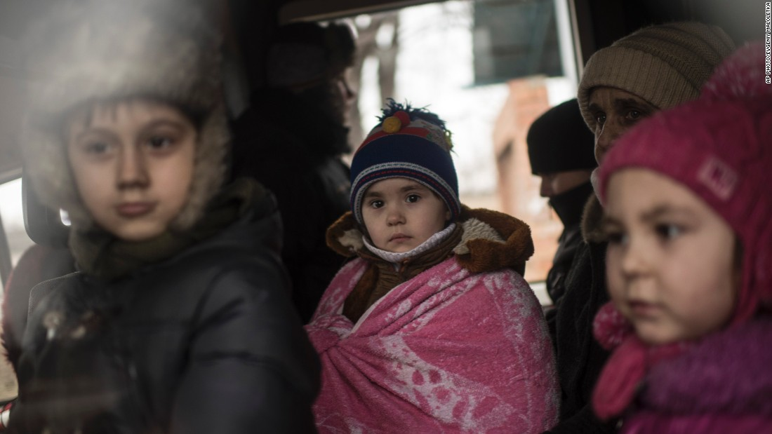 Ukrainian children look through a window of a bus near Artemivsk, eastern Ukraine, on February 5, as people are evacuated.