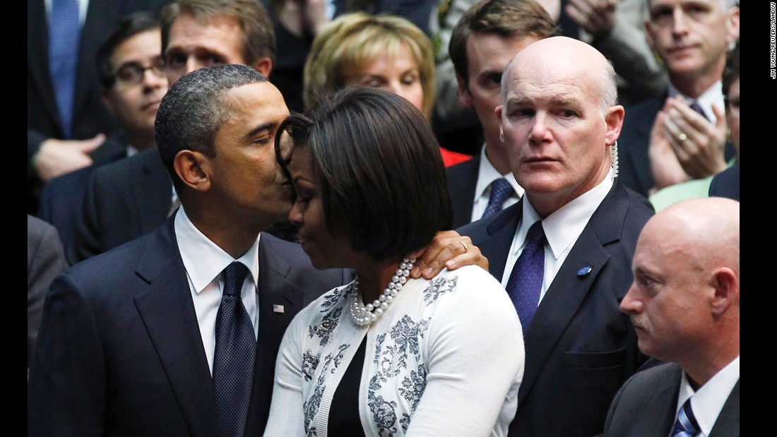 U.S. President Barack Obama kisses his wife, Michelle, during an event in Tucson, Arizona, in 2011. To her right is Secret Service agent Joe Clancy. A White House official said that Clancy, the former chief of Obama's personal security, has been chosen by the President to lead the Secret Service. Clancy has been the agency's interim director for the past four months.
