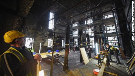Builders at work in the Glasgow School of Art Mackintosh Library in 2015