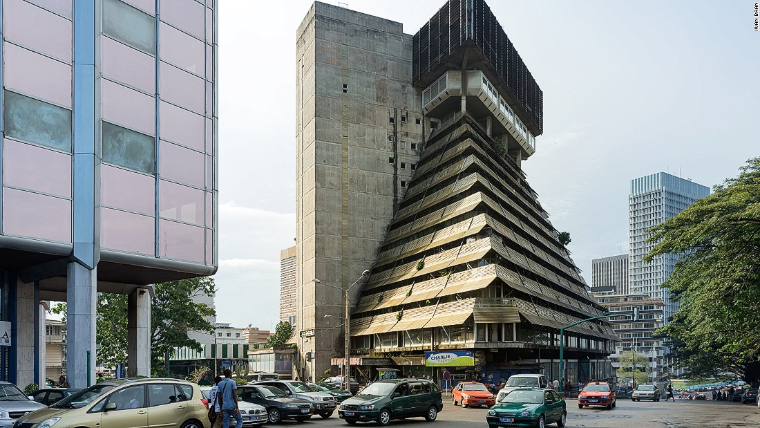 "But despite international designs, climate and resources meant buildings invariably ended up being shaped by local aesthetics. Designed by Italian architect Rinaldo Olivier, La Pyramide was celebrated as one of the Ivory Coast's most impressive structures at the time of its completion.<br />""Côte d'Ivoire, neighbor to Ghana was emphasizing commercial buildings, offices, and housing projects,"" notes Herz.<br />"