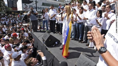 Lilian Tintori (C) wife of jailed opposition leader Leopoldo Lopez speaks during a demonstration in Caracas on February 18, 2015. Venezuelan opposition leader Leopoldo Lopez is imprisoned since February 18th 2014, accused of violent protests in 2014 that left 43 dead people. AFP PHOTO/JUAN BARRETO (Photo credit should read JUAN BARRETO/AFP/Getty Images)