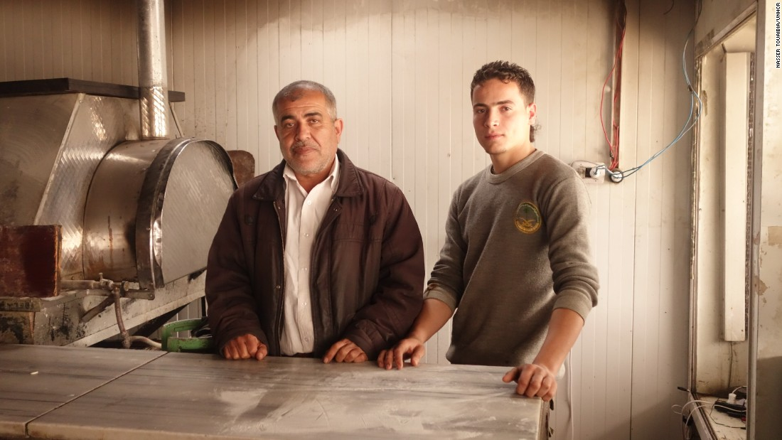 Abu Mohamad, 48, opened his pizza shop with Yehya (right), after meeting him at the Zaatari refugee camp. They're two of many refugees who have become entrepreneurs.
