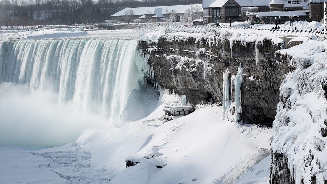 "Niagara Falls is a popular summer attraction, but it can be a spectacular scene in winter as well. An unprecedented cold front in February 2015 froze parts of the falls, drawing tourists to document the rare event. The minus 22-degree weather didn't stop iReporter <a href=""http://ireport.cnn.com/docs/DOC-1217563"">Spencer Wyllie</a> from capturing this photo."