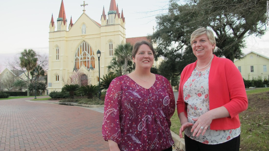 Hours after their February 17 marriage, Meredith Miller, left, and Anna Lisa Carmichael chat in front of Spring Hill College's St. Joseph Chapel, a short walk from the dorm where they met.