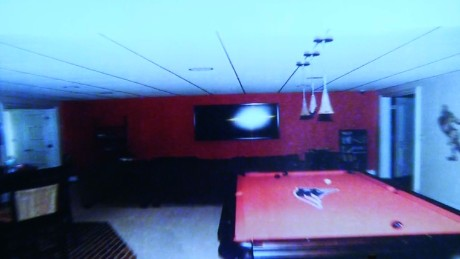 "Hernandez's basement ""man cave"" includes a pool table with a Patriots logo."
