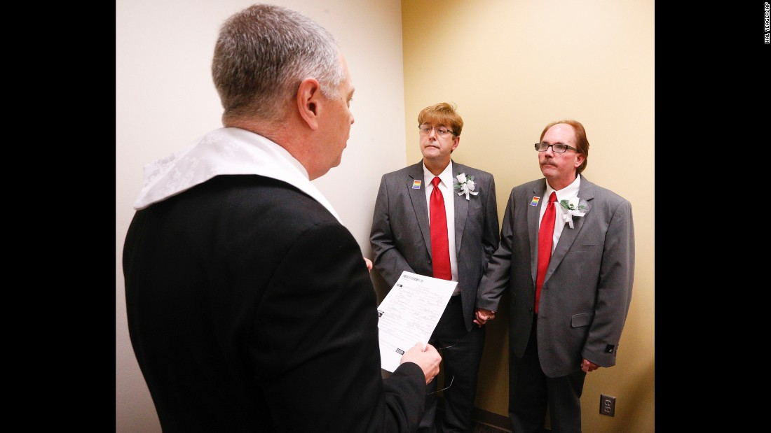 The Rev. Charles Perry of Unity Church marries Curtis Stephens, center, and his partner of 30 years, Pat Helms, at the Jefferson County Courthouse in Birmingham, Alabama, on February 9.