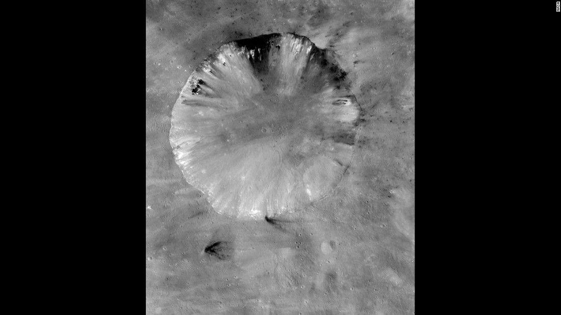 This is Vesta's Numisia crater. It's about 19 miles (31 kilometers) in diameter.