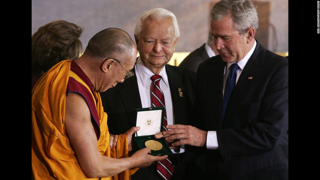 U.S. President George W. Bush presents the Dalai Lama with the Congressional Gold Medal in 2007.