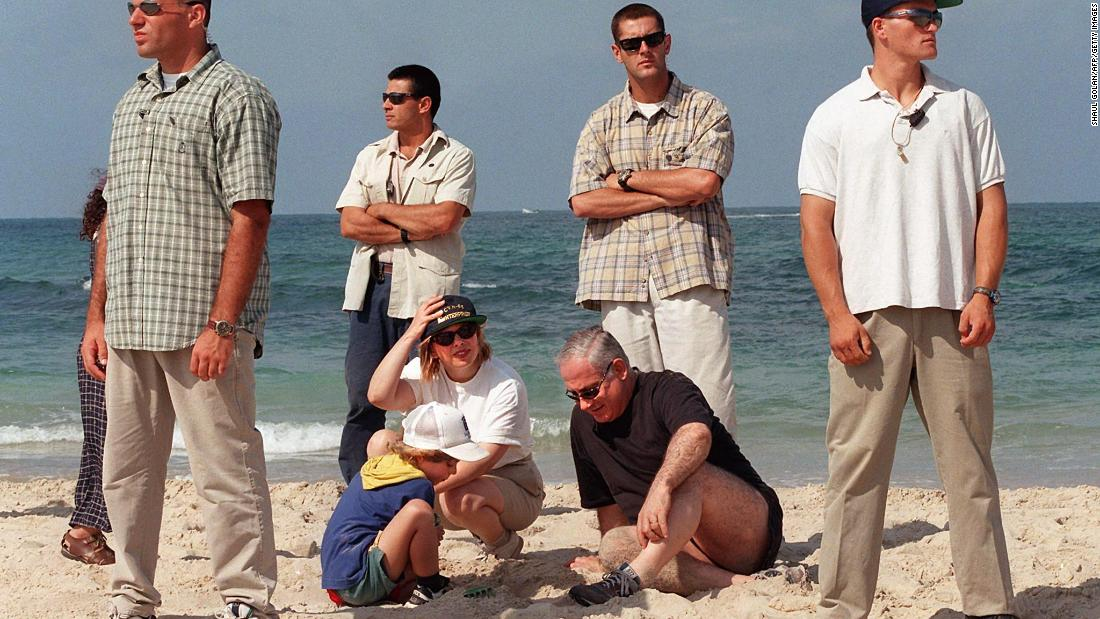 Netanyahu spends the day on the beach with his wife, Sara, and son Avner in Caesarea, Israel, on August 16, 1997.