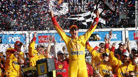 Joey Logano, driver of the #22 Shell Pennzoil Ford, celebrates in victory lane.