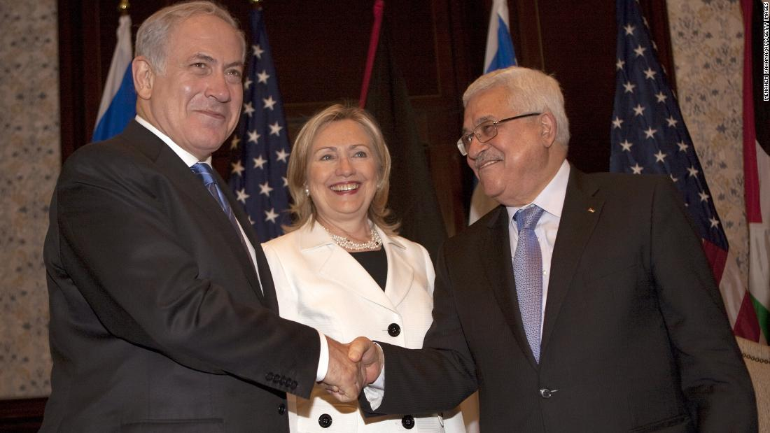 U.S. Secretary of State Hillary Clinton looks on as Abbas and Netanyahu shake hands in Sharm El-Sheikh, Egypt, on September 14, 2010, during a second round of Middle East peace talks.