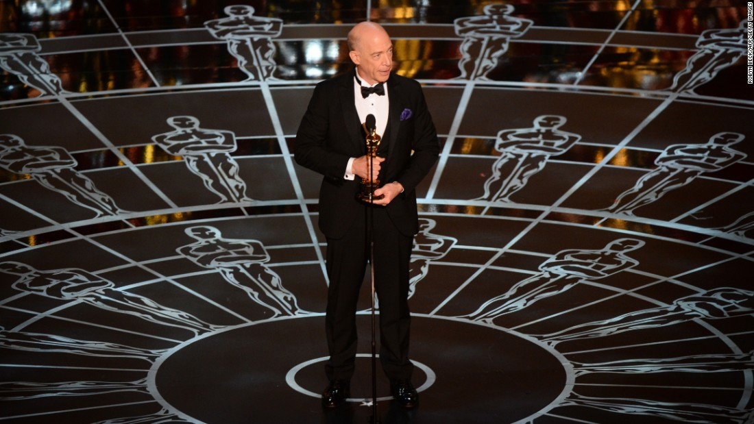 "J.K. Simmons accepts the best supporting actor Oscar for his role in ""Whiplash."" In the first acceptance speech of the night, he paid tribute to his family, praising his wife and his ""above-average"" children. He also put in a plug for actual phone calls. ""Call your mom, call your dad; don't text, don't email; tell them you love them,"" he said."