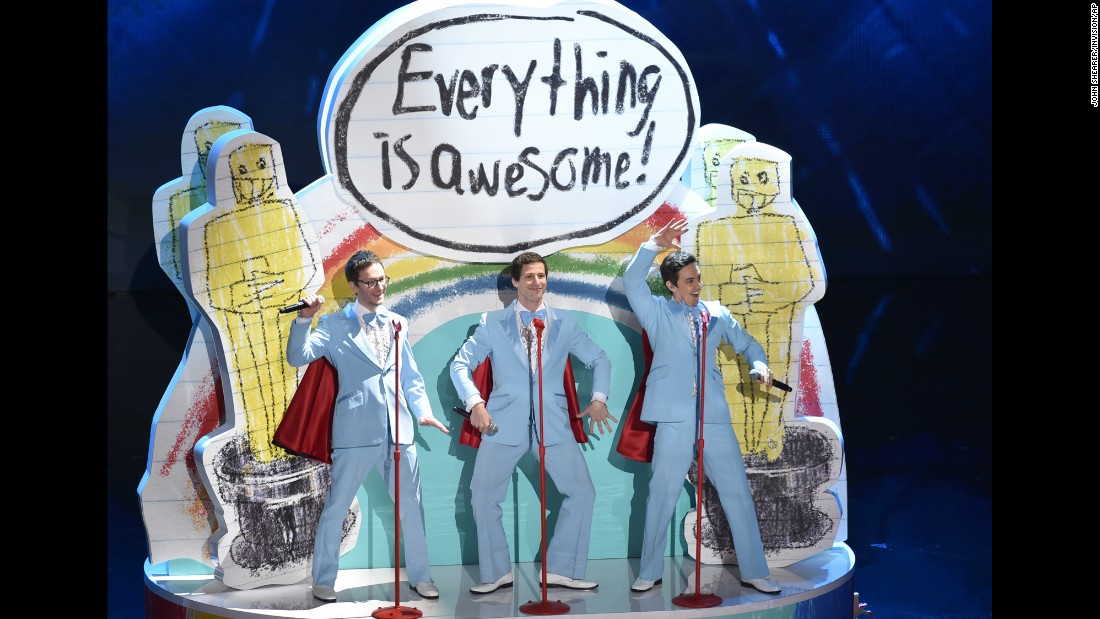 "From left, Akiva Schaffer, Andy Samberg and Jorma Taccone of The Lonely Island take the stage for a rendition of the Oscar-nominated Tegan and Sara song ""Everything is Awesome"" from ""The Lego Movie."""