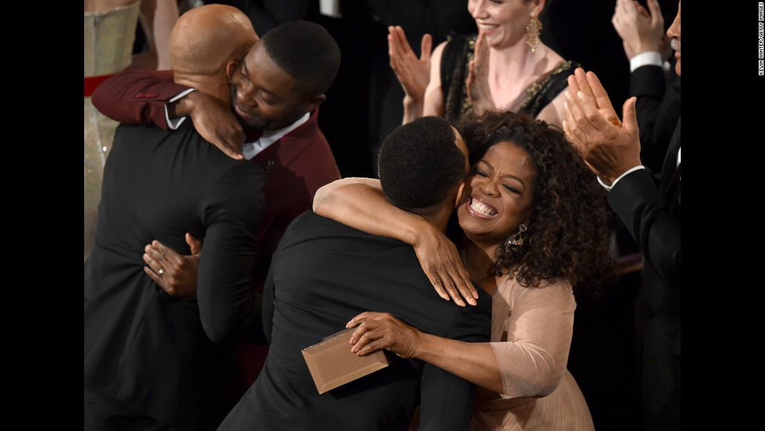 Common, far left, and John Legend are congratulated by actor David Oyelowo and Oprah Winfrey after winning the Oscar for best original song.