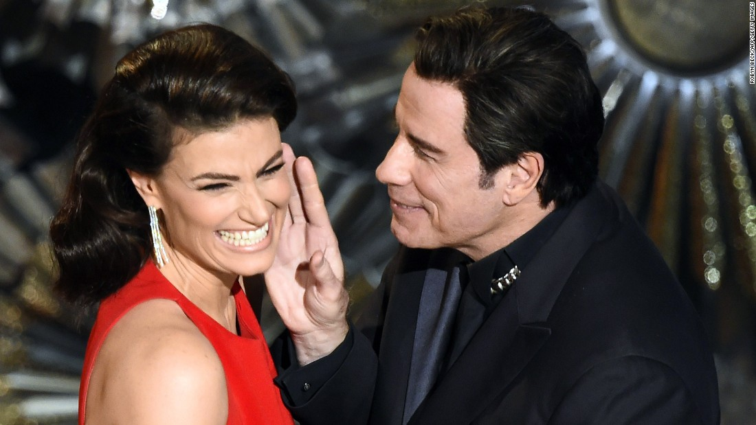 "John Travolta and Idina Menzel present an award together, <a href=""http://www.cnn.com/2014/03/04/showbiz/john-travolta-idina-menzel-oscars/index.html"" target=""_blank"">referencing last year's flub</a> when he mispronounced her name."