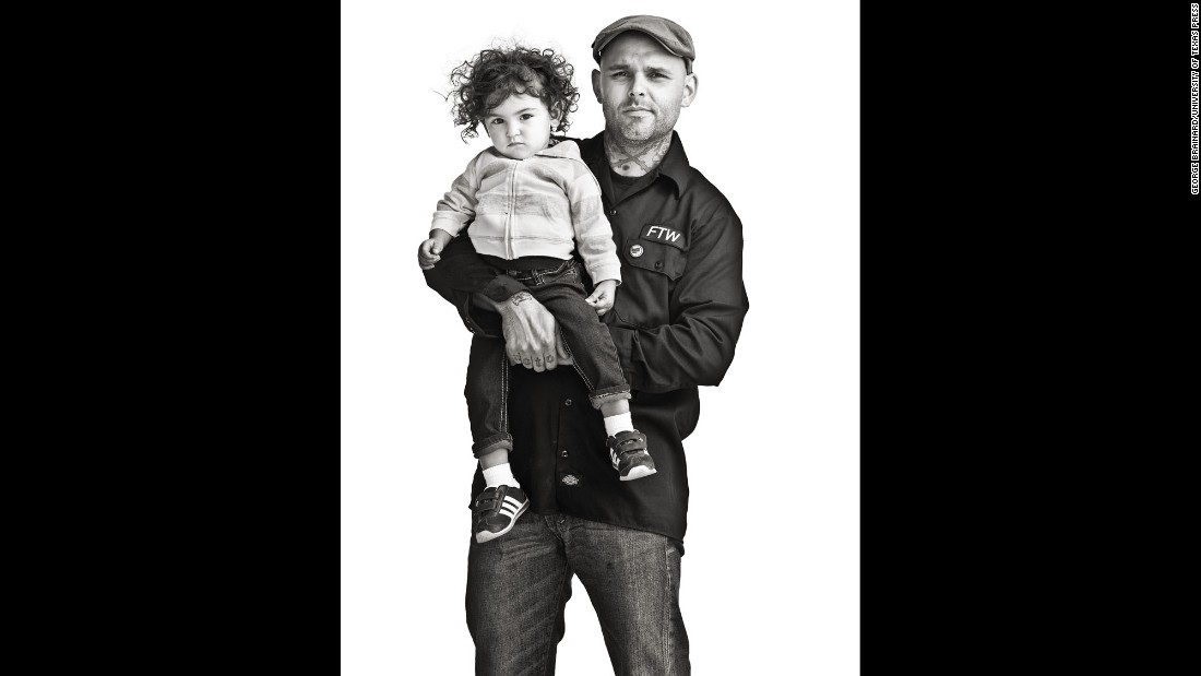 Shaun, a motorcycle tech shop owner in Texas, poses with his daughter.