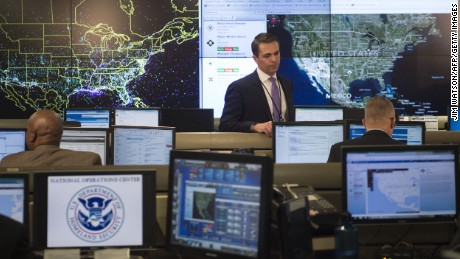 An employee sits at his computer terminal within the National Operations Center (NOC) at the Department of Homeland Security in Washington, DC, February 2, 2015.