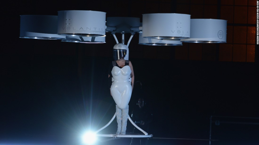 "On November 10, 2013, Lady Gaga took one small step for fashion-kind <a href=""http://marquee.blogs.cnn.com/2013/11/11/lady-gaga-takes-flight/"" target=""_blank"">and debuted a ""flying dress,""</a> essentially a hovercraft-like device, called Volantis."