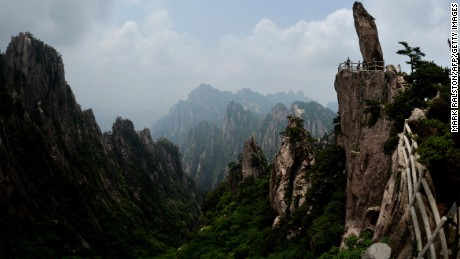 "This photo taken on June 16, 2014 shows the ""Top of Peak"" formation at the Huangshan (Yellow Mountains) park in Anhui Province.  The UNESCO World Heritage Site is one of China's major tourist destinations and has been a source of inspiration to Chinese painters, writers and poets for thousands of years.      AFP PHOTO/Mark RALSTON        (Photo credit should read MARK RALSTON/AFP/Getty Images)"