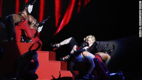 Madonna says she's fine after she took a tumble while performing during Wednesday night's Brit Awards.