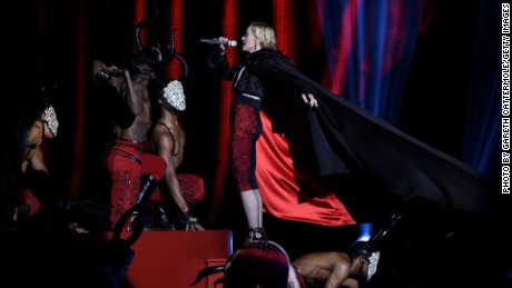 LONDON, ENGLAND - FEBRUARY 25: Madonna just before she falls on stage during the BRIT Awards 2015 at The O2 Arena on February 25, 2015 in London, England. (Photo by Gareth Cattermole/Getty Images)
