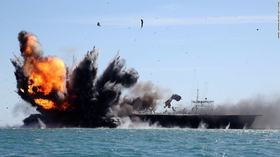 Iran blasts mock U.S. carrier in war games