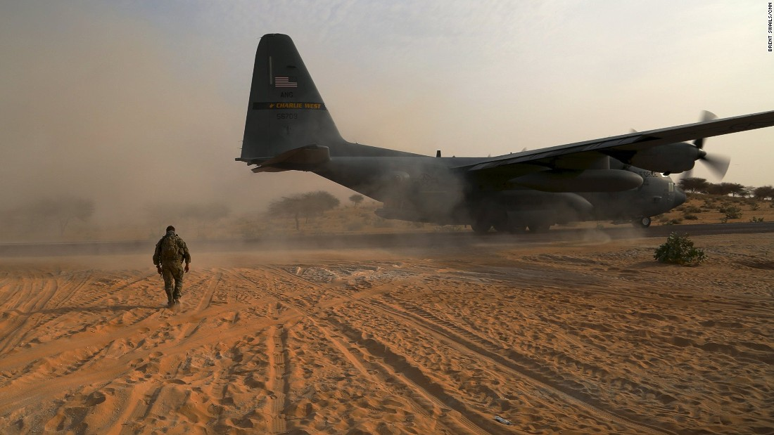 A U.S. Special Forces Operator walks toward a recently landed C130 cargo plane. In just a few short weeks, this barren stretch of Sahel was turned into a functioning military outpost.