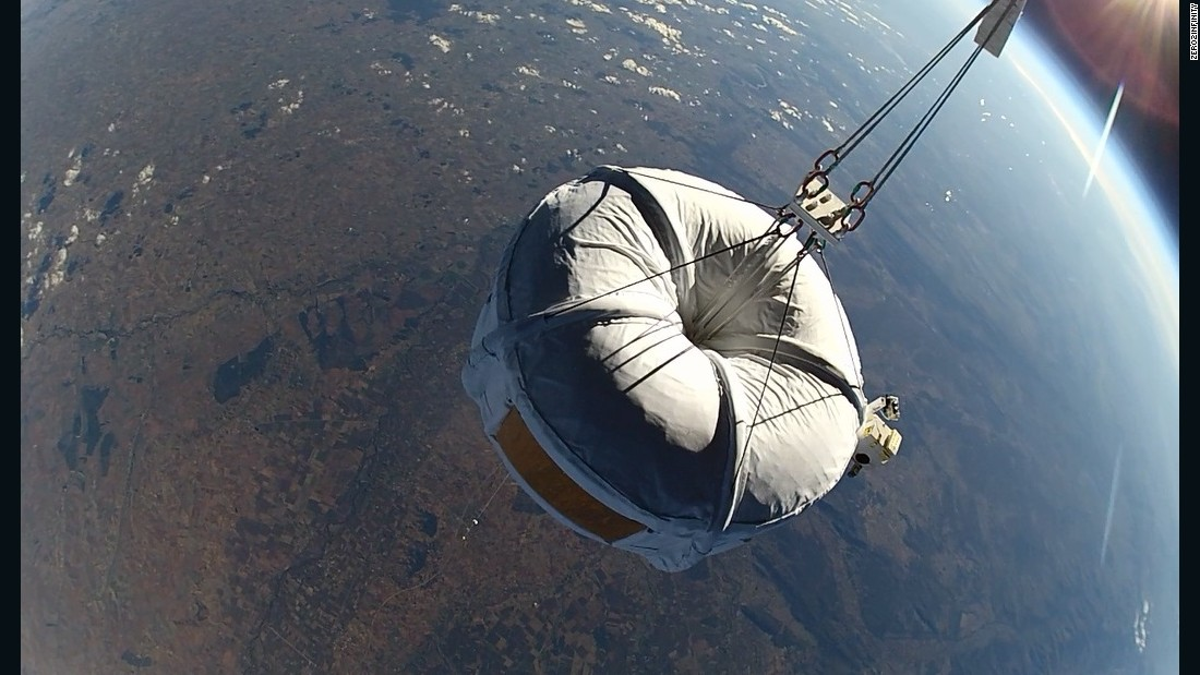"A ""Micro Bloon"" spherical capsule on a test flight, far above the Earth."