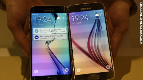 The Samsung Galaxy S6 Edge (L) and Samsung Galaxy S6 are presented during the 2015 Mobile World Congress in Barcelona on March 1, 2015. The 2015 Mobile World Congress, where participants can attend conferences and discover cutting-edge products and technologies, is the world's biggest mobile fair and will be held from March 2 to 5 in Barcelona. AFP PHOTO/ LLUIS GENELLUIS
