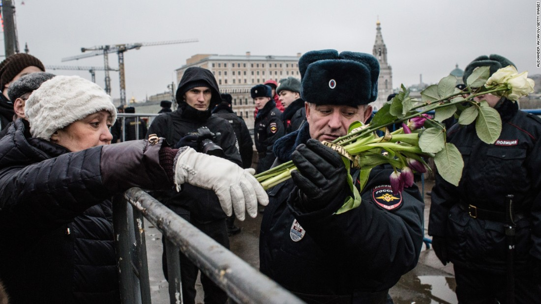 A woman leaves flowers in Nemtsov's memory during a march in central Moscow on March 1.